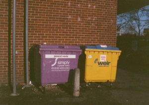 Half frame image of two bins in Banbury on expired Kodacolor VR 100 film